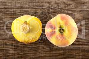 Fresh Raw yellow peach on brown wood
