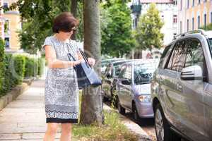 Woman next to car on the street