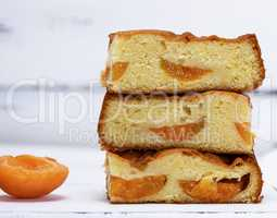 a stack of baked square slices of a biscuit pie with apricots