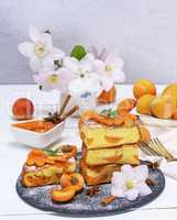 pile of square pieces of a biscuit pie with apricots
