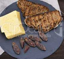 pieces of smoked salami, cheese and toast from bread