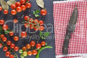 ripe red cherry tomatoes and knife