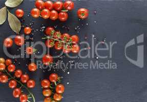 cherry tomatoes on the twigs sprinkled with salt and pepper