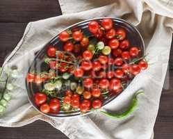 ripe red cherry tomatoes on an iron plate