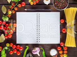 notebook in a line  and ingredients for cooking Italian pasta
