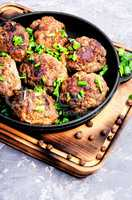 Delicious meatballs in frying pan
