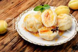 Dumplings with apricot and spicy syrup