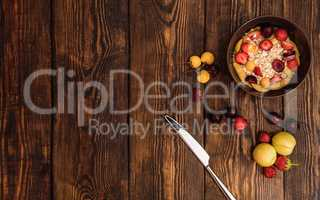 Breakfast with porridge, ripe fruits and berries