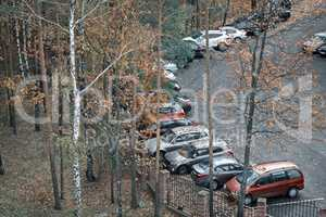 Cars parked near the fence of the Park.