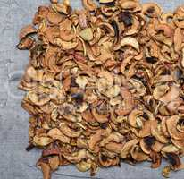 dry apple slices on a gray linen napkin