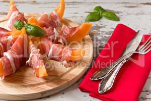 Cutting board with prosciutto and melon
