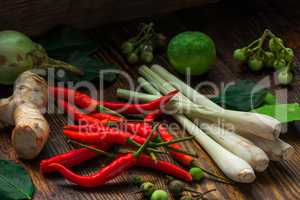 Tom yam ingredients set for Thai cuisine on wooden table