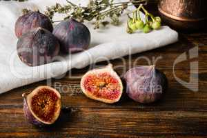 Ripe figs on the cloth with sliced one