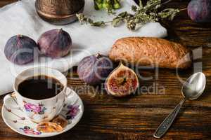Cup of coffee with fresh bun and some figs