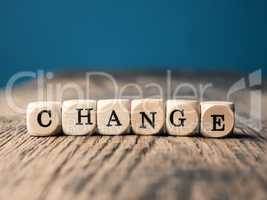 The word Change on small dices