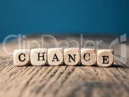 The word Chance on small dices