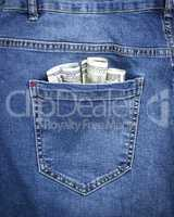 banknotes of the American dollar in the back pocket