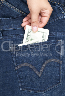 hand pulls out of the back pocket of blue jeans bill hundred do