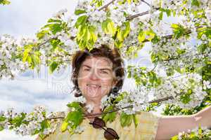 Woman on the tree with cherry blossoms