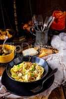 Reginette noodles in cream sauce with fresh chanterelles and cap