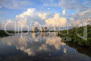 Reflection of clouds in the water at Sunrise over the riverway o