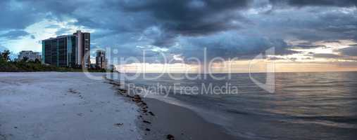 Rain pours from dark clouds over Clam Pass Beach in Naples, Flor