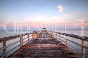 Early sunrise over the Naples Pier on the Gulf Coast of Naples,