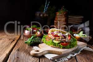 Crunchy pita with grilled gyros meat. Various vegetables and gar