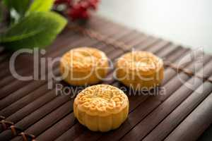 Moon cakes on bamboo mat low light with copyspace
