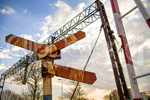 Railway gate with rusty warning sign
