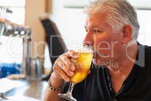 Handsome Man Tasting A Glass Of Micro Brew Beer