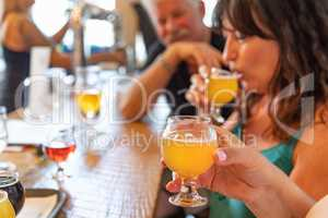 Group of Friends Enjoying Glasses of Micro Brew Beer At Bar