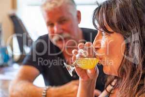 Couple Enjoying Glasses of Micro Brew Beer At Bar