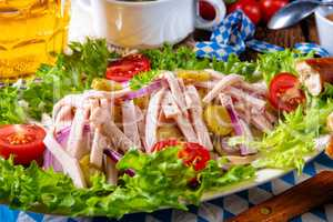 delicious bavarian sausage salad with onion and cucumbers