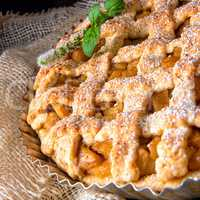 Tasty Apple pie with lattice upper crust