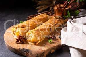 Tasty autumnal omas pancakes with apple and cinnamon