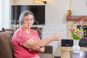 Elbow pain in a hand at elderly person