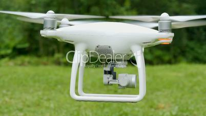 Drone equiped with four rotors and a camera flying