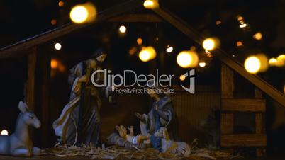 Jesus Christ Nativity scene with atmospheric lights and candles