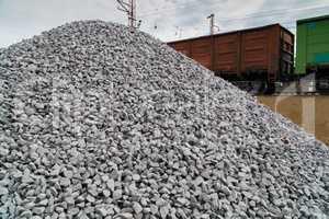 Railway. Transportation of crushed stone by rail. Unloading railway platform.
