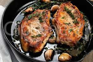 Roasted pork steak in frying pan