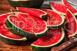 Watermelon slices lying on wooden table