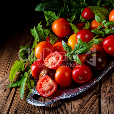 various types of tomatoes served and presented on the silver pla