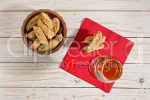 Italian cantucci biscuits and vin santo wine over a red napkin