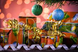 Christmas gifts with blurred lights on background and ribbon und