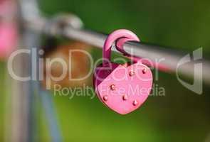 Closed pink padlock