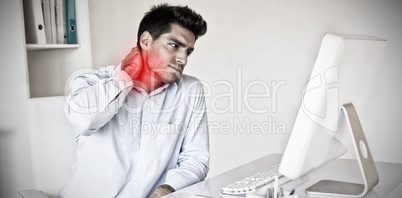 Composite image of casual businessman touching his sore neck