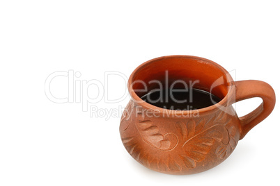 Coffee in a clay cup isolated on white background. Free space fo