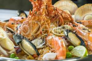 Paella with fresh lobster, scallops, mussels and prawn