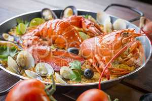 Paella with fresh lobster, clams, mussels and squid